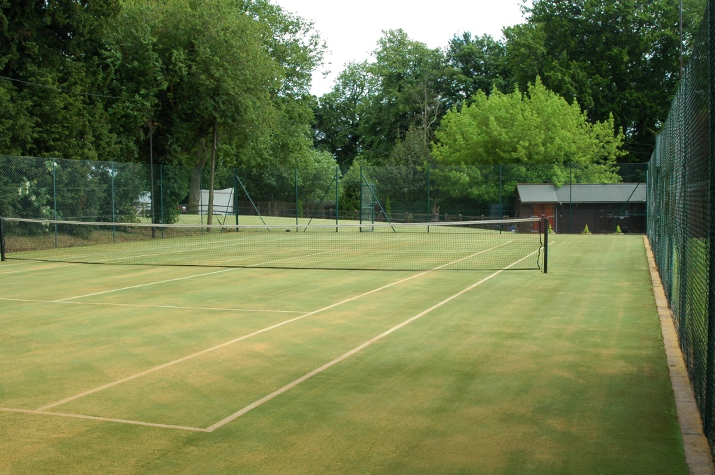 how to clean artificial grass tennis court